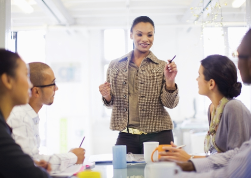 Woman manager leading team in meeting