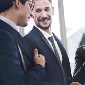 Financial Advisors talking to clients.