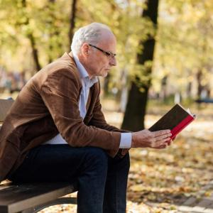 Senior reading book